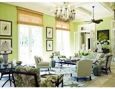 In this oceanfront Palm Beach house, designer Allison Paladino glazed the sunroom walls bright green to capture the light and painted the woodwork white to calm it down. Click through for more green decorating ideas.