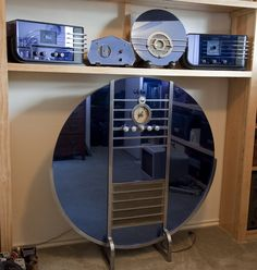 """The Sparton Mirrored Radios, designed by Walter Dorwin Teague, were among the most beautiful ever produced. The initial 1936 Teague-designed series consisted of four radios whose release was preceeded by an advertisement showing four covered objects with the caption """"The Style Sensation of the radio world is under these covers."""""""