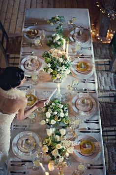 white table, floral centrepiece - napkin /menu as colour highlight?