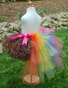 """""""Mom Prom"""" - Custom made to match the theme of this year's 3rd annual Mom Prom event (I've included the picture of the cake I got my inspiration from ). This one is made of almost 10 yards of black tulle I splatter painted with the theme colors. It is accented by an adorable bustle done in sparkle pink, yellow, orange, and blue, as well as a double-sided satin ribbon sewn to both sides. Tutu; bustle tutu; costume; splatter paint. By Enchanted Ever After."""