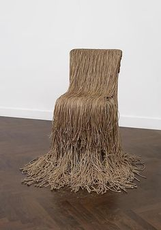 Gunther Uecker  String Chair, 1969  Kitchen chair with back and seat cover with long strings pulled through holes.