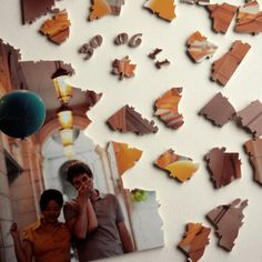 lovely alternative to wedding guest book: custom made photo puzzle. Guests sign the back of the puzzle pieces