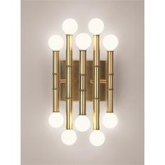 Check out the Robert Abbey 686 Jonathan Adler Meurice 10 Light Wall Sconce in Antique Brass