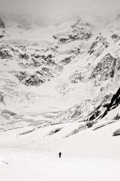 """""""Traversing beneath the immense and avalanche-prone 3000m high north face of Pik Pobeda (7439m, Tien Shan, Kyrgyzstan). Taken on the way to remote Pik Pobeda East (6762m), prior to making the first ski descent."""" — August 2010"""