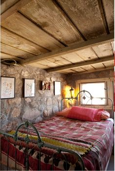 Rustic cozy cabin bedroom, love the rough wood ceiling and stone wall #decor #interior