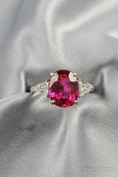 Platinum, Ruby, and Diamond Ring, set with an oval-cut ruby measuring approx. 10.84 x 8.57 x 5.44 mm, and weighing 4.66 cts., flanked by fancy-cut diamonds, no. 4212