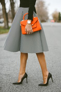 Pin stripped skirt and a pop of color with an orange accessory ❤️