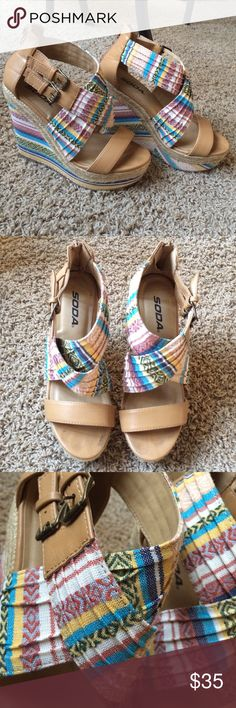 Aztec Printed Wedges Omg these are so cute. I've only worn them a few times because they're so pretty and I don't want them ruined. They're just really tall! But they are comfy and supportive. You'll just feel like a model in them! Zipper in back but adjustable straps on side. Check out my page for more cute things! Soda Shoes Wedges