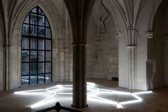 Cellula 2009 installation view – Collège des Bernardins, Paris light structure made of 18 fluorescent tubes Ø 26 150 cm | 59.1 inches (6), 120 cm | 47.2 inches (10), 60 cm | 23.6 inches (2) wood cutouts + scaffolding