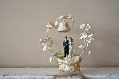 antique wedding cake topper: 1920s cake topper with arch and bell