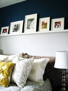 shelf cuts wall inhalf, two seperate colors, pictures on shelf, frames in lower part of the wall's color. Do this in lower level where we have a ledge already. Bed Picture, Picture Ledge, White Picture, Home Bedroom, Bedroom Wall, Bedroom Ideas, Bedrooms, Pictures Over Bed, Shelf Over Bed