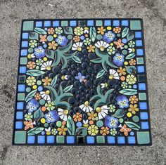 One of our most popular table designs! This listing is for a CUSTOM MADE floral garden mosaic table. The mosaic shown is an example of a