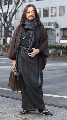 "oh my, how beautifully he managed to assort this outfit of modern and traditional Japanese elements! the scarf is totally genius, it matches the kimono (or yukata?) perfectly.    ""Photo taken on a Tokyo street, featuring a brave man showcasing how one can simultaneously look both modern and hold on to old traditions."""