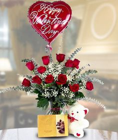 The Romance Package! Ecuadorian Red Roses, Godiva Chocolates, Cuddly Bear, Balloon.  Carithers Flowers, Atlanta's Florist!  http://www.carithers.com/flowers/Roses-Godiva-Bear-Atlanta/
