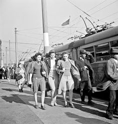Baltimore, Maryland. Rushing to catch a trackless trolley home from work at four pm, 1943