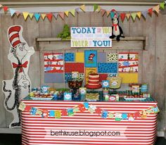 Love, love, love this Dr. Seuss party! The backdrop with the fabric covered canvases is adorbs!
