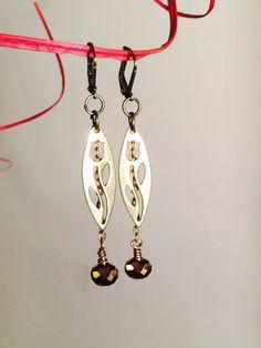 "Brass Lass Earrings. Beautiful brass Tulip ""Stencils"" and antique brass Czech glass beads dangle from chain onto brass leverback earwires. by GemJelly on Etsy https://www.etsy.com/listing/219665473/brass-lass-earrings-beautiful-brass"