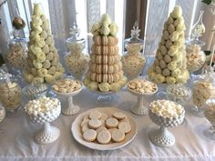 Stunning dessert display at a  white wedding party! See more party planning ideas at CatchMyParty.com!