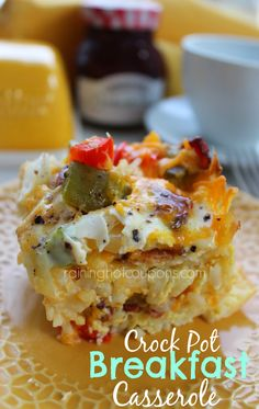 Crock Pot Breakfast Casserole   * 1 bag Frozen Hash Brown Potatoes (32 oz) * 1 lb Bacon  * 1 Small Onion diced  8 oz Shredded Sharp Cheddar Cheese 12 Eggs  1 cup Milk