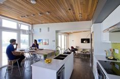 915 Sq. Ft. Small House for Roommates Published on DECEMBER 30, 2014 Green House Design, Kitchen And Bath, White Kitchen Cabinets, Kitchen Island, Modular Homes, Prefab Homes, Solar, Decathlon, Roommates