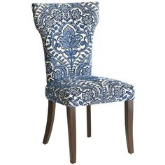 A slim profile loaded with handcrafted details that include thick, comfortable padding, a blue damask front with covered button accent and gently curved birch legs. Who knew that even chairs can never be too thin or too rich?