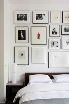Monochrome / black and white gallery wall in a minimal bedroom via Bertolini Architects
