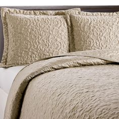 Luxurious tonal texture makes the Bombay Signature full/queen coverlet and shams perfect layering pieces for other Bombay bedding collections. Constructed in beautiful charmeuse fabric for a luminous sheen and a silky finish. Contemporary quilt stitching gives glamorous appeal. Shams include 2 flange.