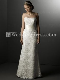 $268 A demure lace wedding gown features a wide natural waist. Strapless neckline is slightly curved. Luxurious lace overlay of great motif veils a satin skirt in a sheath silhouette. Hidden back zipper. This gown, with no train, is also suitable for an outdoor wedding or as a reception dress.