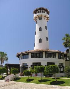 White lighthouse in the marina of Cabo San Lucas, Baja California, Mexico.