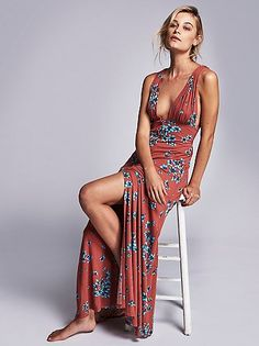 Other Days Maxi   Floral printed maxi dress featuring a plunging V-neckline with brass colored button closures down the front. Strappy back with an adjustable fit. American made.
