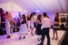 Dance Floor underneath fully draped marquee as provided by Elite Marquee.