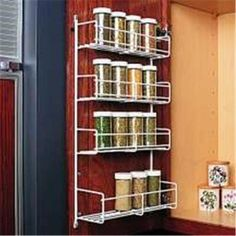 Feeny Fesr In. MPN: FESR Door mount wire spice rack in white and frosted nickel. Features 3 tiers for spices and one deep tier for canned goods. Door Storage, Storage Cabinets, Spice Rack White, Kitchen Doors, White Furniture, Home Organization, Spices, Home And Garden, Hardware
