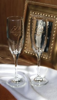 "50th Wedding Anniversary Champagne Flutes Celebrate your anniversary and toast to 50 years together with these engraved champagne flutes. Flutes feature ""50th Anniversary"" design in gold. Size: 8 3/4"""
