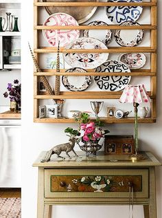 A Scandinavian Pine Plate Rack From Design Works In Cape Cod Hangs On A  Wall Adjacent