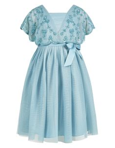 Our Alicia party dress for girls is a perfect choice for special occasions. This vintage-inspired style features a cape bodice with exquisite beading, a removable grosgrain ribbon tie and a full tulle skirt. Fully lined.