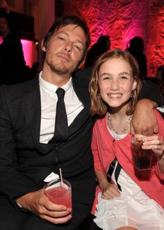 Norman Reedus and Madison Lintz attend the after party for AMC's 'The Walking Dead' Season 2 at Vibiana on October 3 2011 in Los Angeles California