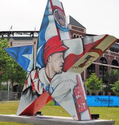"""This Stars of Texas is titled """"America's Pastime"""" by artist Justin Simmons. It's located at Globe Life Park outside the northwest entrance. Paula and Grey Pierson helped underwrite the piece -- one of 20 different artistic stars in Arlington at varied locations (they're also pictured on this board). The Stars project is supported by the Arlington Museum of Art, the Tomorrow Foundation and Women In Philanthropy."""