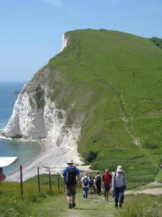 The Jurassic Coast, UK - a part of where I now live. It's breath-taking to stand on the 'edge' and feel so very small. Culture Of England, Uk Bucket List, Dorset Coast, Rule Britannia, Jurassic Coast, England And Scotland, Places Of Interest, English Countryside, British Isles