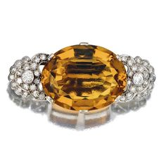 CITRINE AND DIAMOND BROOCH claw-set to the centre with an oval citrine, between shoulders millegrain-set with circular- and single-cut diamonds. Royal Jewelry, Vintage Jewelry, Fine Jewelry, Trophy Wife, Diamond Brooch, Gems And Minerals, Brooches, Topaz, Diamond Cuts