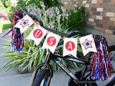 We're excited to be partnering up with a new group of bloggers to be able to offer a new set of printables every month. First up, a banner for Independence Day. This USA Banner can go any where! Hang it from a shelf, on a door, wall, and even on a bike! I've always wanted an excuse to deck my kids bikes out in red, white, and blue so I couldn't pass up the chance with this banner. I love it some much I think I might organize a bike parade for the 4th! Just download, cut out, and tie together…
