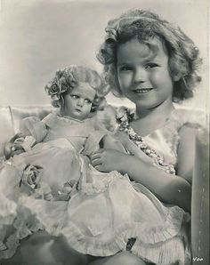 Shirley Temple with a Lenci doll.