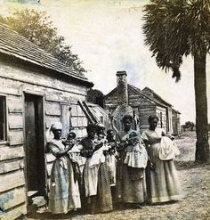 Five African-American women pose with their babies in St Helena Island, South Carolina, 1866