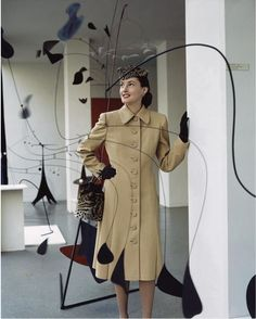 The art of fashion. @glamour Photographed by John Rawlings for the January, 1944 issue at the Museum of Modern Art with an Alexander Calder sculpture. #glamour #moma #calder #vintagefashion To purchase a print, visit condenaststore.com/?utm_content=bufferd6fe5&utm_medium=social&utm_source=pinterest.com&utm_campaign=buffer