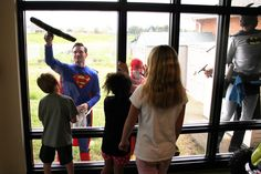SUPER-CLEAN WINDOWS -- Our windows got a power washing today (SUPER-POWER washing, that is) thanks to Superman, Batman and The Flash from Superhero Window Washing of Fayetteville. The grime-fighting team came out to give us some free window-cleaning service and spend some time with our awe-struck kiddos as part of their community giving initiative.