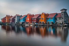 Happy Houses, by Nick Knol Groningen is the main municipality as well as the capital city of the eponymous province in the Netherlands. With a population of 197,823, it is the largest city in the north of the Netherlands. #Architecture #Design #portrait #Beautiful #Illustration