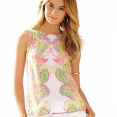SALEIona shell hottie pink lilly top Gorgeous and iconic Iona shell top in Hottie pink. Worn one time in perfect condition! Still have the tags and extra button! Gorgeous top with button up back absolutely gorgeous vibrant colors. ✋No trades✋ please no Lowballing Lilly Pulitzer Tops