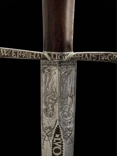 Look at this cool engraving.. .Sword. Swiss, about 1500.