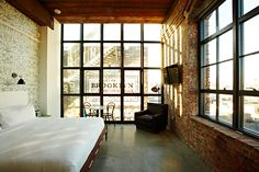 The Historic King Room of the industrial-chic Wythe Hotel in Brooklyn, NY. a 1901 waterfront factory transformed into a beautiful hotel which carefully preserved the brick masonry, loft-style windows and pine beams. Loft Interior, Interior Architecture, Interior And Exterior, Design Hotel, House Design, Hotel A New York, New York City, Wythe Hotel Brooklyn, Brooklyn Nyc
