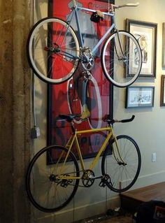 We've always loved a good DIY bike rack, and while the previous two racks we've featured grew progressively more streamlined, it's hard to imagine a more minimalist bike storage unit than this DIY rack. Hanging Bike Rack, Diy Bike Rack, Bike Hanger, Bicycle Rack, Indoor Bike Storage, Indoor Bike Rack, Bicycle Storage, Indoor Bike Stand, 25 Life Hacks