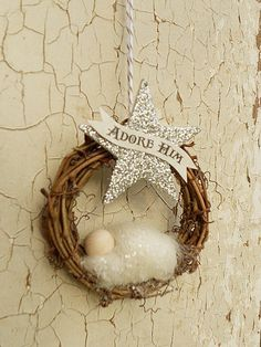 This is the Primitive Version of our ADORE HIM ornament. We thoughtfully hand make each ornament to share a message of hope through our Savior Jesus Christmas making this ornament a very special and unique gift. Oh come let us Adore Him baby Jesus ornament. Natural twig wreath